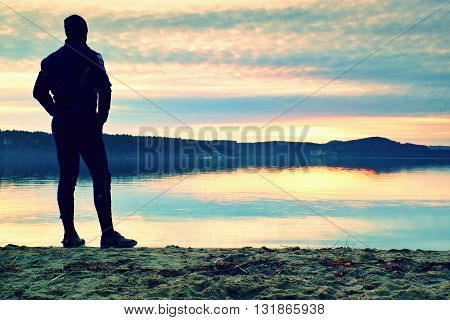 Silhouette Of Alone Person On  Decline Seeing Over Bay To Sun