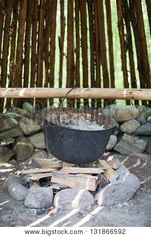 Pot for cooking over the fire. Closeup view