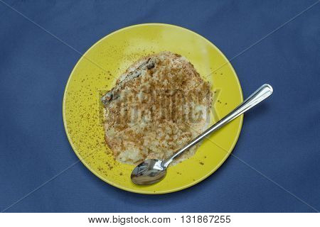 Rice pudding and sprinkled cinnamon, on the table