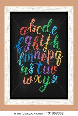 Chalk colorful hand drawn latin calligraphy brush script of lowercase letters on the blackboard. Calligraphic alphabet. Vector illustration