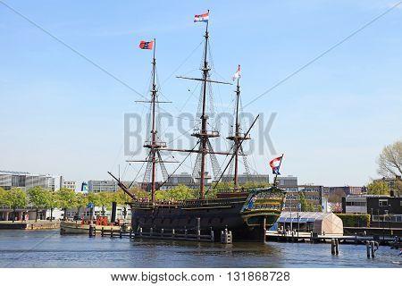 AMSTERDAM, NETHERLANDS - MAY 6, 2016: The Dutch sailing cargo ship of 17 century near Maritime museum, Amsterdam, Netherlands