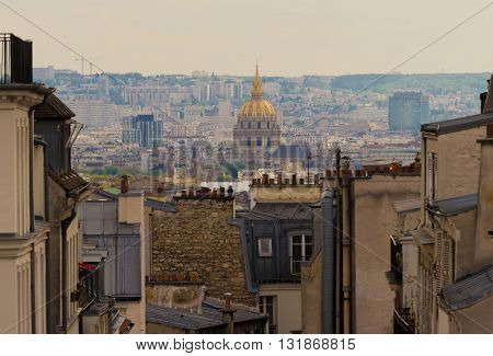 The Invalides museum and Montmartre houses Paris France.