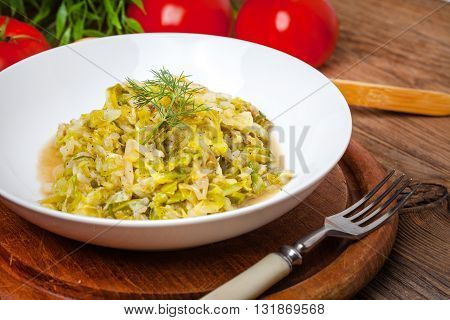 Fried Cabbage Greens And Onion In Wooden Table.