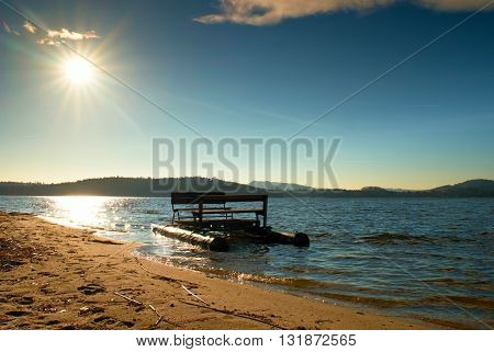 Abandoned Old Pedal Boat Caught  On Sea Sandy Beach At Sunset