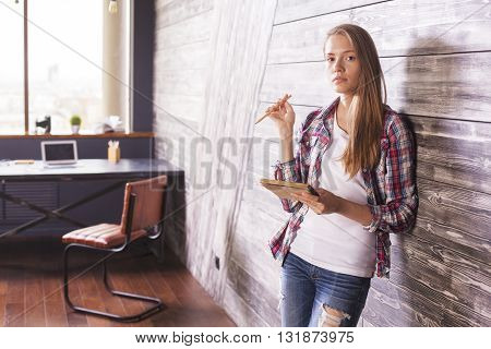 Girl With Copybook In Hands