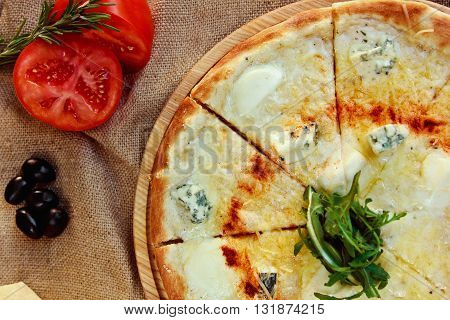 Cheese Pizza With Four Types Of Cheese On A Wooden Board