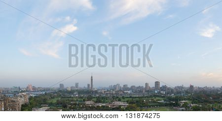 Cairo Egypt - May 22 2016: Central Cairo skyline at dusk the Nile river the Island of Zamalek and the 6th October Bridge and the Cairo Tower.