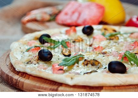 Big Tasty Pizza With Seafood, Shrimp On A Wooden Table