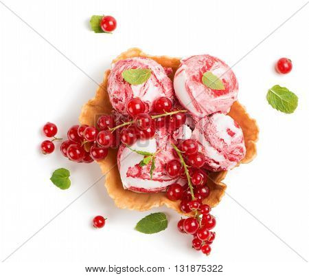 Top view of vanilla and redcurrant marble ice cream in a wafer bowl decorated with mint and fresh berries isolated on white background.