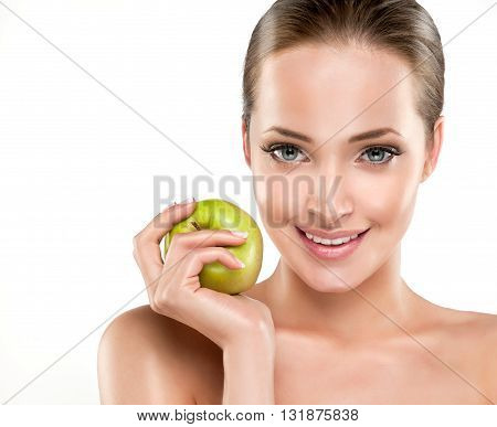Beautiful girl holding a green Apple in his hand . Cosmetology , beauty , skin care and Spa