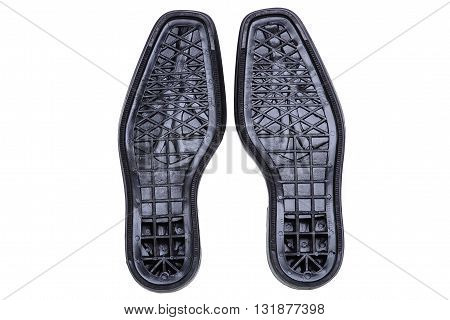 Pair of black men's shoes soles on white background