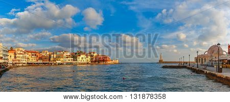Panoramic view of old harbour of Chania with Lighthouse and Kucuk Hasan Pasha Mosque in summer morning, Crete, Greece