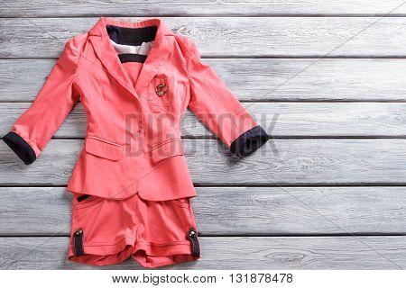Salmon short suit. Short suit on wooden background.