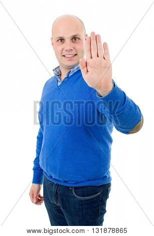 young man making stop with his hand, isolated