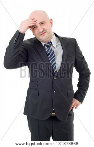 Businessman in a suit gestures with a headache, isolated
