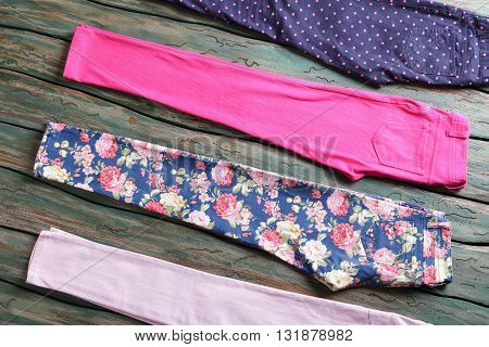 Casual pants with floral print. Lady's bright pink trousers. New items from spring collection. Selection of discounted merchandise.