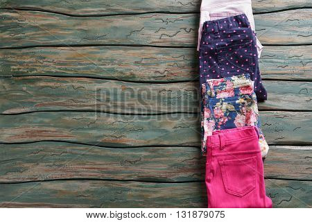 Folded trousers with dotted print. Dark navy casual pants. Lady's new garments in showroom. Low prices in outlet shop.