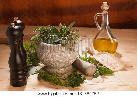 Various Spices On A Wooden Table With Mortar, Pestle And Mills.