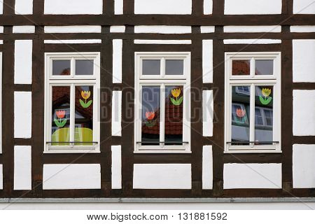 Three windows of half-timber medieval house in Hameln, Germany.
