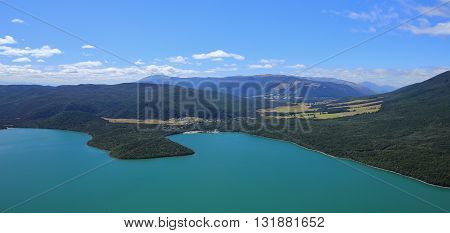 Landscape in New Zealand. View from Mt Robert. Turquoise Lake Rotoiti. Village St Arnaud and forest.