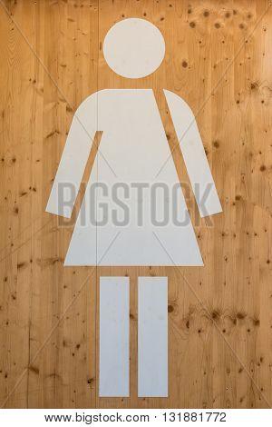 Female WC Sign White Restroom Symbol on Wooden Background