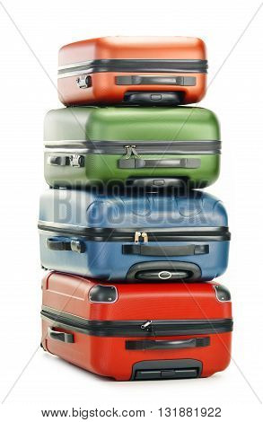 Four Polycarbonate Suitcases Isolated On White