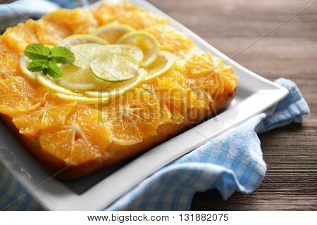 Delicious citrus cake on wooden background