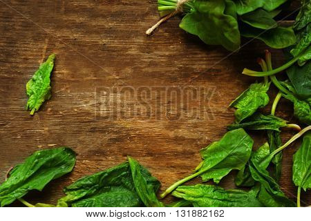 Fresh spinach leaves on wooden background