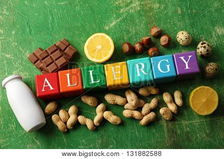 Allergy food concept. Wooden cubes with allergic food