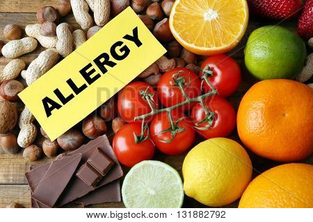Set of allergic food on wooden table, top view
