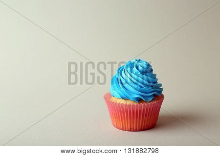 Birthday cupcake on color background
