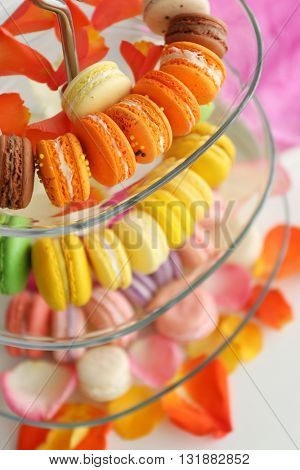 Fresh macaroons on a cake stand, closeup
