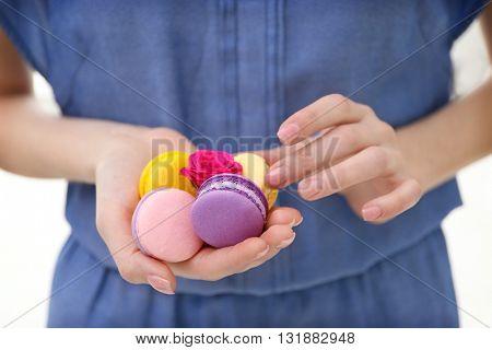 Woman holding macaroons, closeup