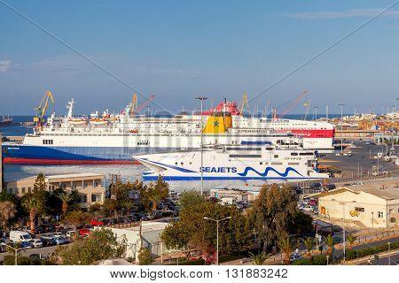 Heraklion, Greece - April 23, 2016: Passenger ships in the sea port of Heraklion. Port in Iraklone is a major passenger and cargo hub in Crete.
