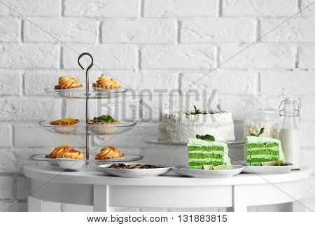 Different delicious desserts on table