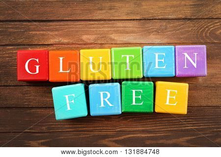 Gluten-free diet concept. Colorful cubes on wooden background