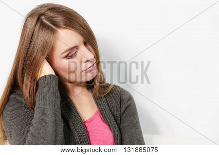 Face emotional expression of sadness. Unhappy worried thinking woman depressed girl deep in thought. Female contemplating life.