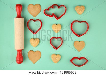 Cookies in heart shape for Valentine's Day on turquoise background