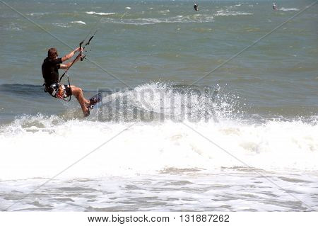PHRACHUAP KHIRI KHUN,THAILAND-DECEMBER 20,2013 : Unidentified Kite surfer in action at Phranburi sea near Phranburi District. Preparation starting from the beach in Phrachuap Khiri Khun ,Thailand.