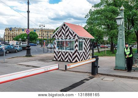 St.Petersburg Russia - May 17 2016: policeman resting a lantern near the barrier on Ioannovsky bridge.