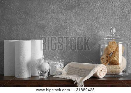 Bath accessories on grey wall background