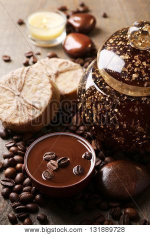 Composition of spa treatment, flowers and coffee beans on wooden background