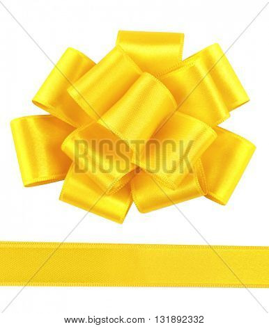 Yellow satin bow and ribbon isolated on white