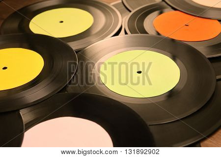 Vinyl records with multicolored labels, background