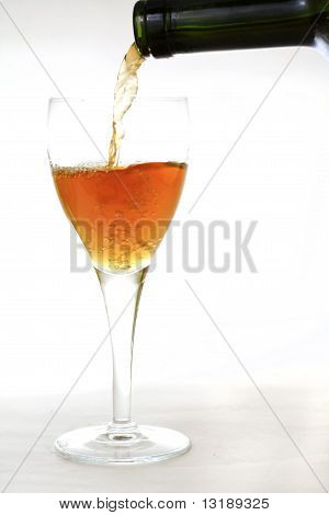 White Wine Filling A Glass