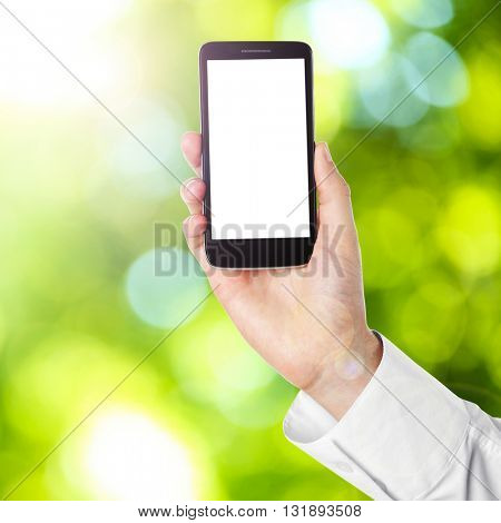 Hand shows mobile smart phone, nature blurred background