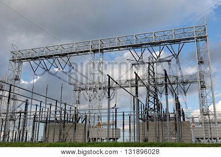 High voltage electric station under blue sky