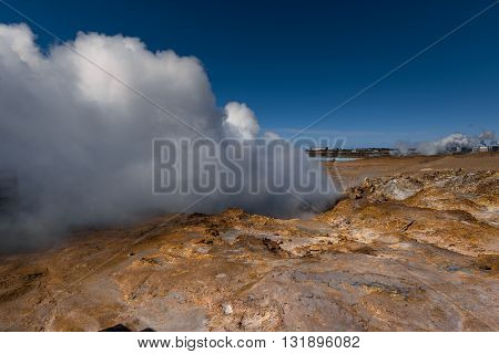 Geothermally active valley with geysir at Iceland