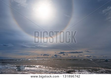 Sun halo on the shore of Jokulsarlon glacier lagoon