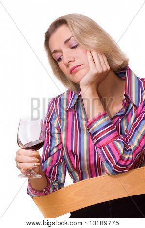 Sad blond girl drinks wine